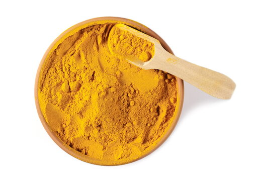 Turmeric powder (Curcuma) in bowl, pot with wooden spoon isolated on white background, top view