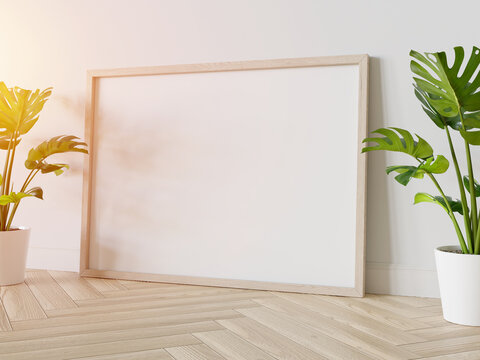 Wooden frame leaning on floor in interior mockup. Template of a picture framed on a wall 3D rendering