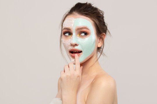 Delight woman with clean skin. Beautiful young skin and anti-aging cream mask