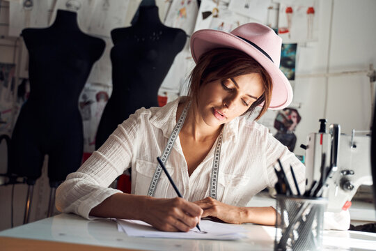 Designer concentrated on sketches of new collection