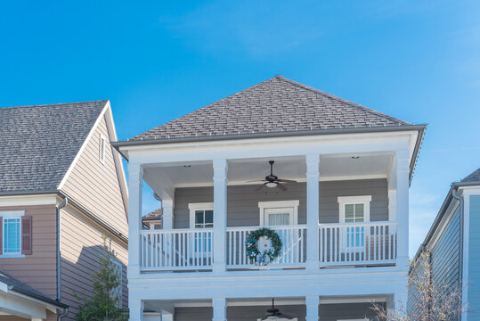 Urban townhome with second story balcony and Christmas wreath decoration near Dallas, Texas, USA