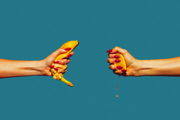 Hands with banana and lemon. Modern art collage in pop-art style. Hands isolated on trendy colored background with copyspace, contrast. Modern design with copyspace for advertising. Trendy colors.
