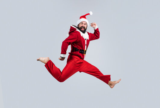 happy caucasian man jumping on christmas party, santa claus