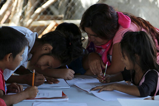 """A teacher looks after their students in a classroom of a makeshift school that the children of Mexican drug lord Joaquin """"El Chapo"""" Guzman helped to build near the city of Culiacan"""
