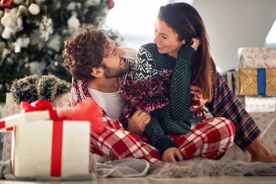 Romantic couple sharing gifts on Chrismas morning