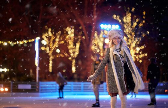 A young girl enjoying skating at ice rink. Skating, hobby, winter