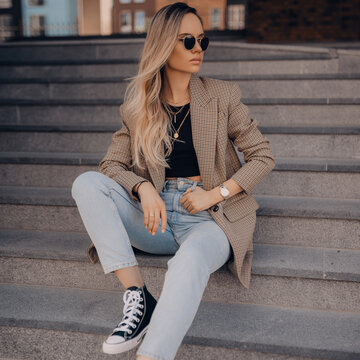 Stylish fashion woman posing on the street