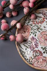 Decorative plate on pastel color background