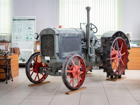 KIEV, UKRAINE-JULY 23, 2019: 1931 old Soviet tractor HTZ 15/30 in the Polytechnic Museum at Ukrainian National Technical University