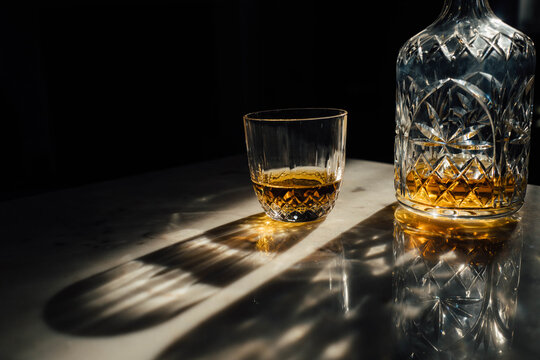 Crystal decanter and glass containing whisky