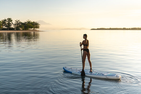 Woman On Stand Up Paddle Surfboard