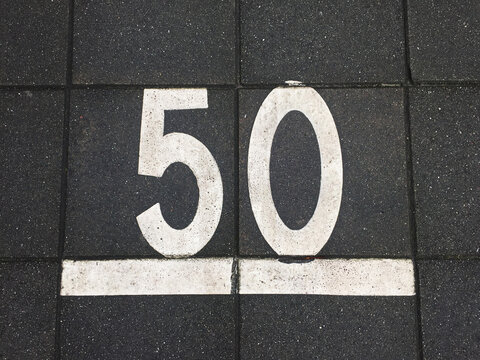 sidewalk tiles with number 50 on it