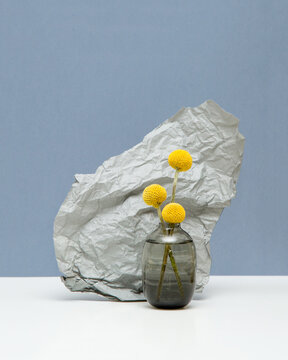 Small yellow flowers in a vase