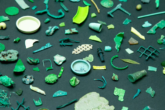 Pieces of green plastic on the green background