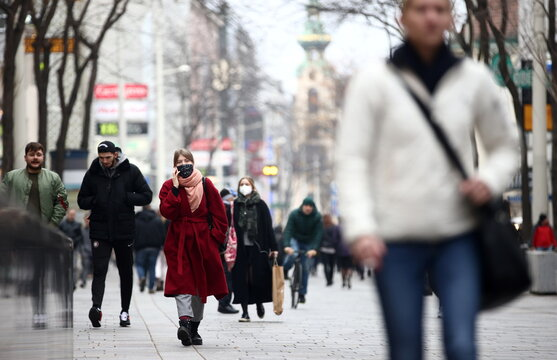 People with protective masks walk down a shopping street during the second lockdown as the coronavirus disease (COVID-19) outbreak continues in Vienna
