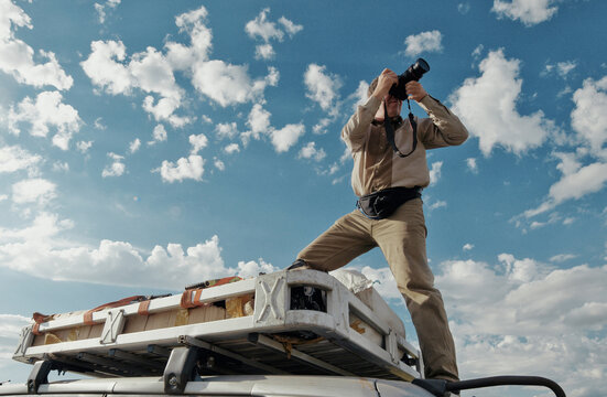 Film color. Nature photographer photographed on the roof of the