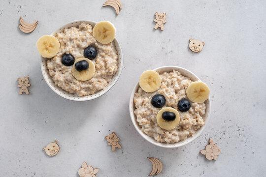 Kids breakfast oatmeal porridge with funny bear face