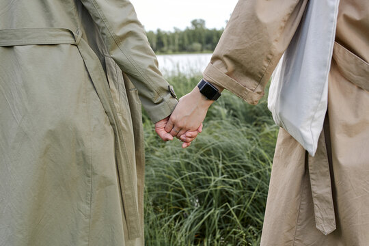 two girls hold hands in the Park, on the hand of smart watch