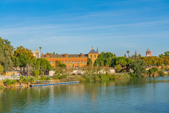 Historical Palacio de San Telmo in Baroque architecture on the green embankment of Guadalquivir river in Seville, Spain