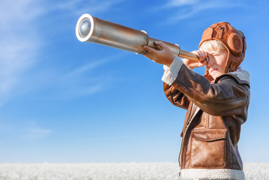 Young aviator with a telescope