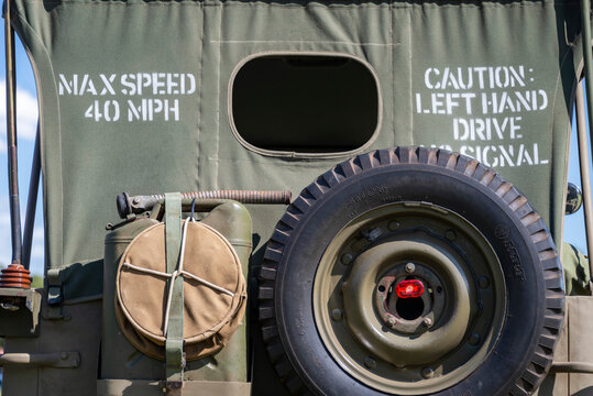 Old army vehicle, military green, with a left hand drive caution and a max speed indication