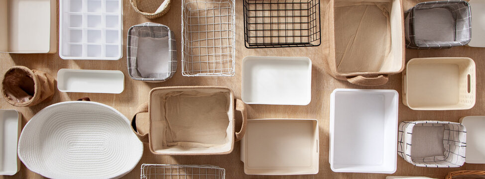 Flat lay of Marie Kondo's storage boxes, containers and baskets with different sizes and shapes