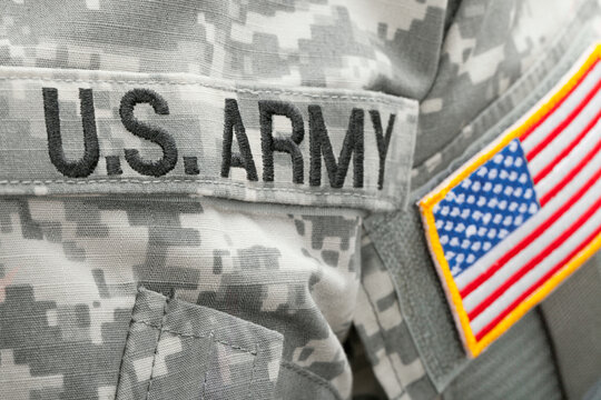 WARSAW, POLAND - JANUARY 26, 2015: US flag and U.S. ARMY patch on military uniform - close up shot