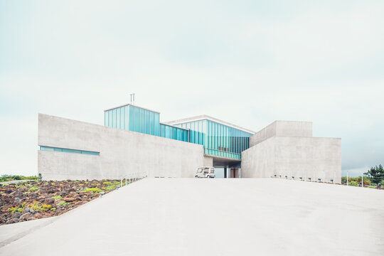JEJU ISLAND, SOUTH KOREA - August 19th, 2015: Modern art museum building built on the pathiway to famous Seongsan mountain at the shore of volcanic origin Jeju Island - South Korea