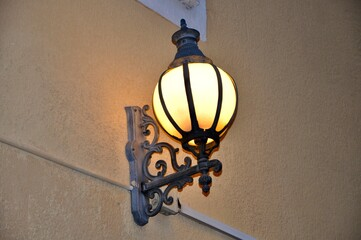 Architecture detail with street lamp. Graceful beauty of a usual street lantern. Fotomurales