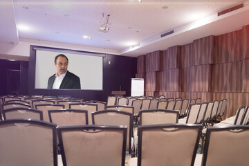 Online education,male african  teacher on the projector screen. Online education concept with...