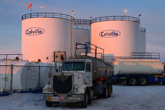 Gas tanks and tanker trucks at sunrise in Deadhorse, Alaska - October 15, 2013