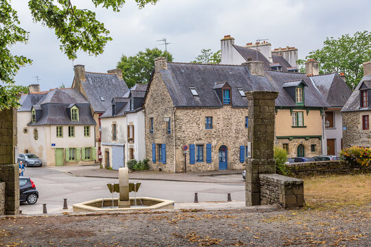 Josselin, France. Landscape with a fountain on the street Lucien Briend