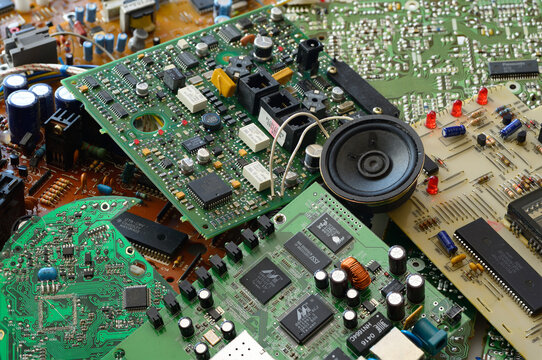 Collection of junk electronic components with microchip integrated circuit boards Toronto, Canada - March 31, 2014