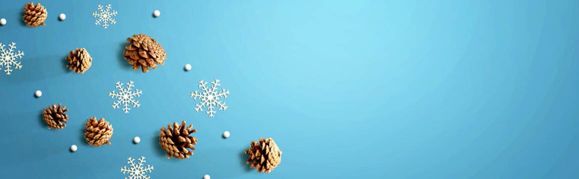 Christmas pine cones with snow flakes - flat lay