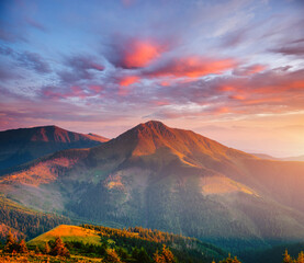 Wall Mural - Tranquil evening landscape in the mountains at sunset.