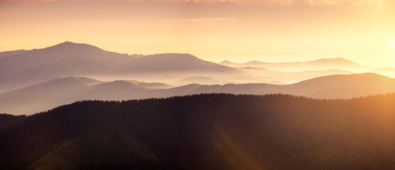 Wall Mural - Panoramic evening landscape in the mountains at sunset.