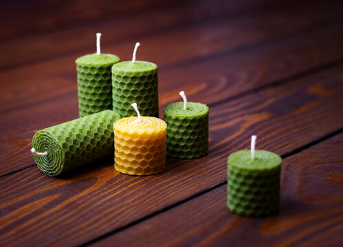 beeswax candles on a dark wooden table