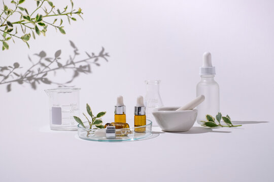 Skin care laboratory for natural beauty cosmetic product. Mock up bottle with pestle and mortar.