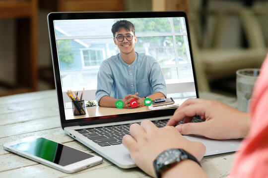 Video conference, Work from home, Asian man making video call to business team with virtual web, Contacting asia colleague by conference on laptop computer at home