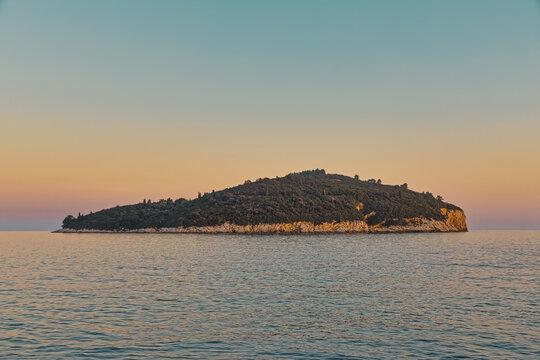 Golden hour sunset panorama of the island Lokrum near Dubrovnik old city in Croatia Europe.