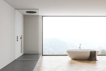 White bathroom interior with tub and shower