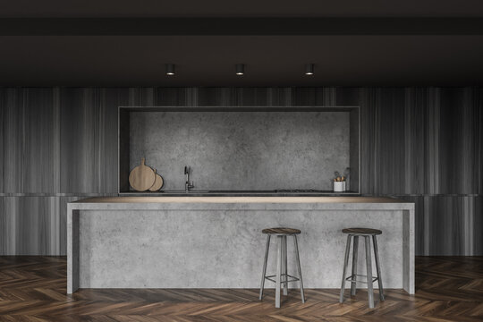Dark gray kitchen interior with bar