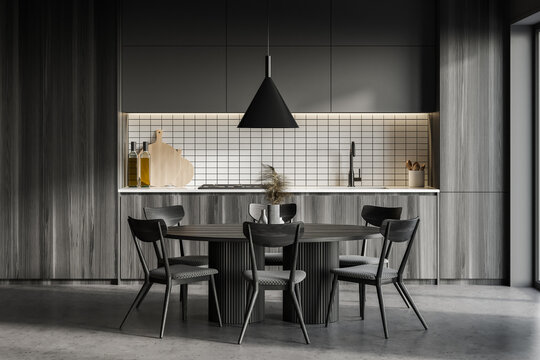 Dark wooden kitchen interior with dining table