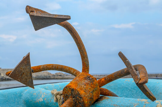 Closeup of an old, rusty anchor on an old fishing boat in Muscat, Oman