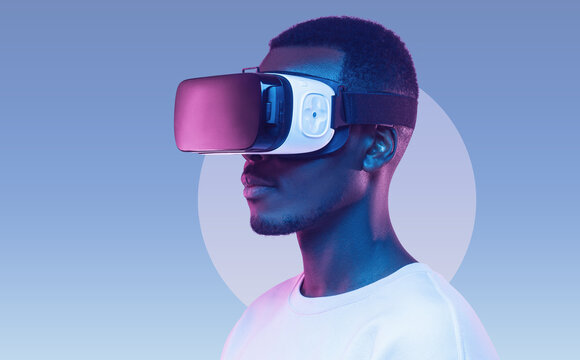 Young african american man wearing virtual reality headset. VR concept