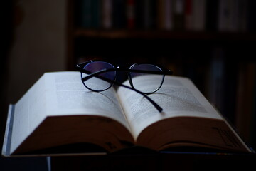 These glasses and thick books can be used as a background for computer screens, posters, banners,...
