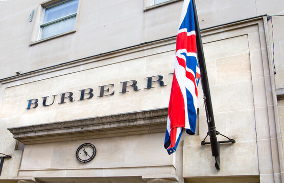 London, UK - August 13, 2019: Burberry. Old Bond street view with flags of famous fashion houses. Bond Street is a major shopping street in the West End of London for luxury designer brands