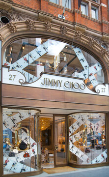 London, UK - August 13, 2019: Jimmy Choo logo and designer shop at Old Bond street in Mayfair. Old Bond street is the best destination for designers luxury brands and jewellery