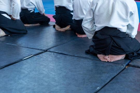 People in kimono and hakama on martial arts training