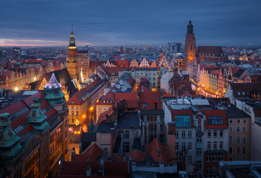 Aerial panorama of illuminated old town part of Wroclaw after the sunset. Poland